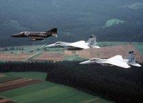 1280px-RF-4E_AG51_F-15As_33TFW_1982.jpg